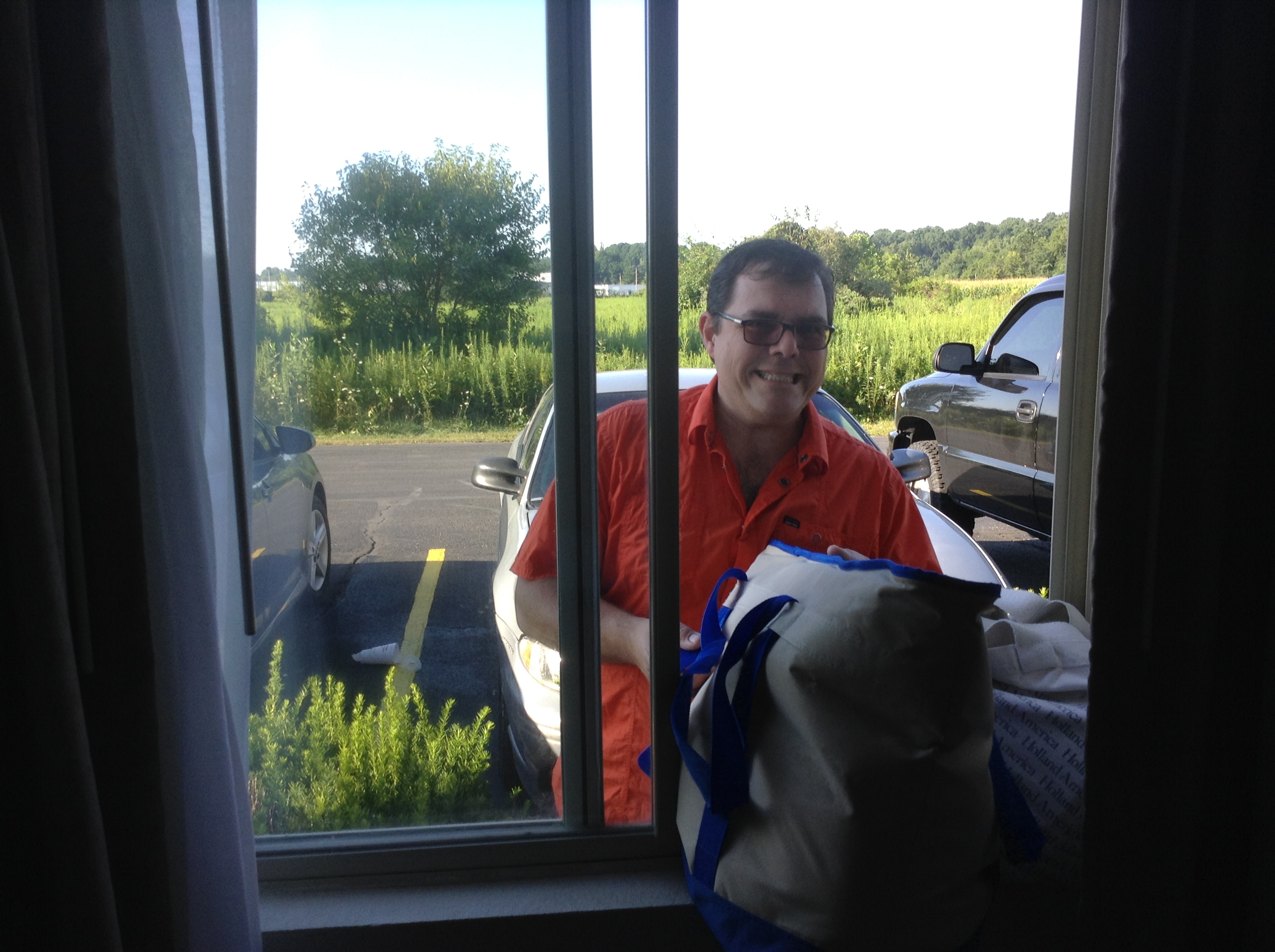 Packing the car from our hotel room window!  What a great idea!