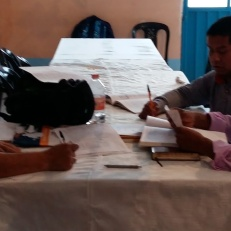 Moises and pastors marking exams from the study group who graduated