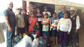 Delivering Goods to a family who lost their home and daughter in a land slide