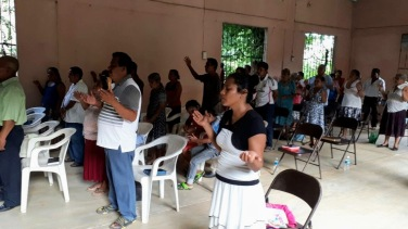 Church service leading communion in Las Margaritas