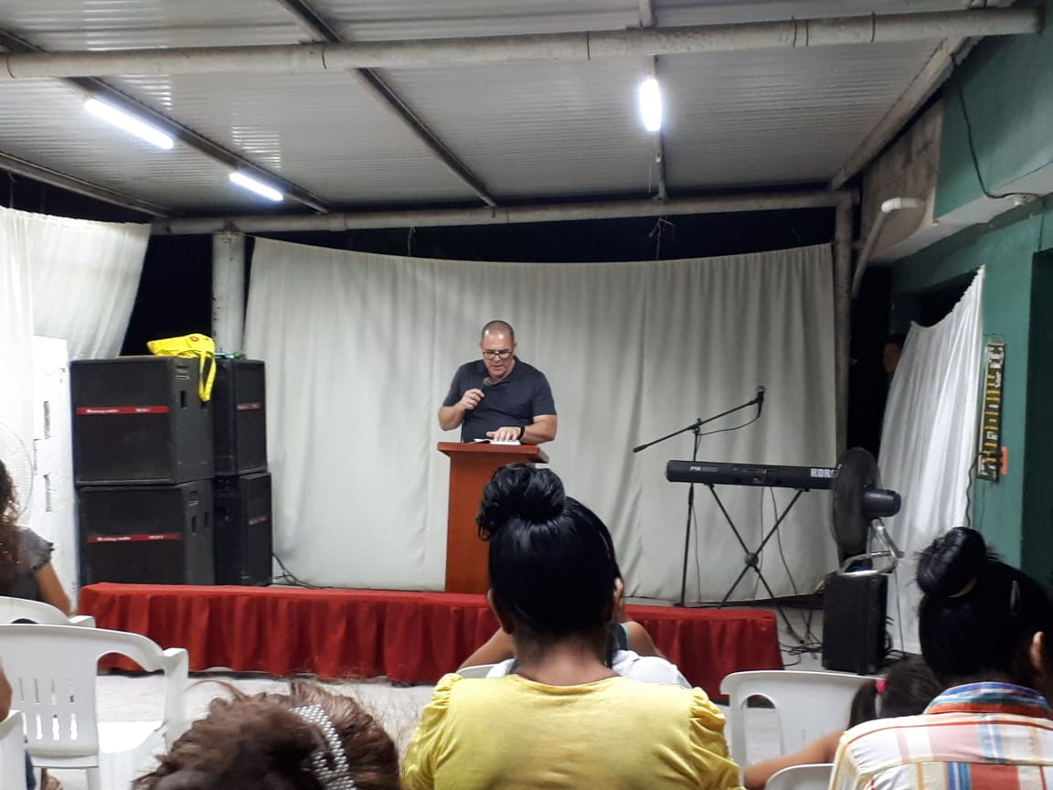 Phil preaching in a church service. They are eager to start studying as well