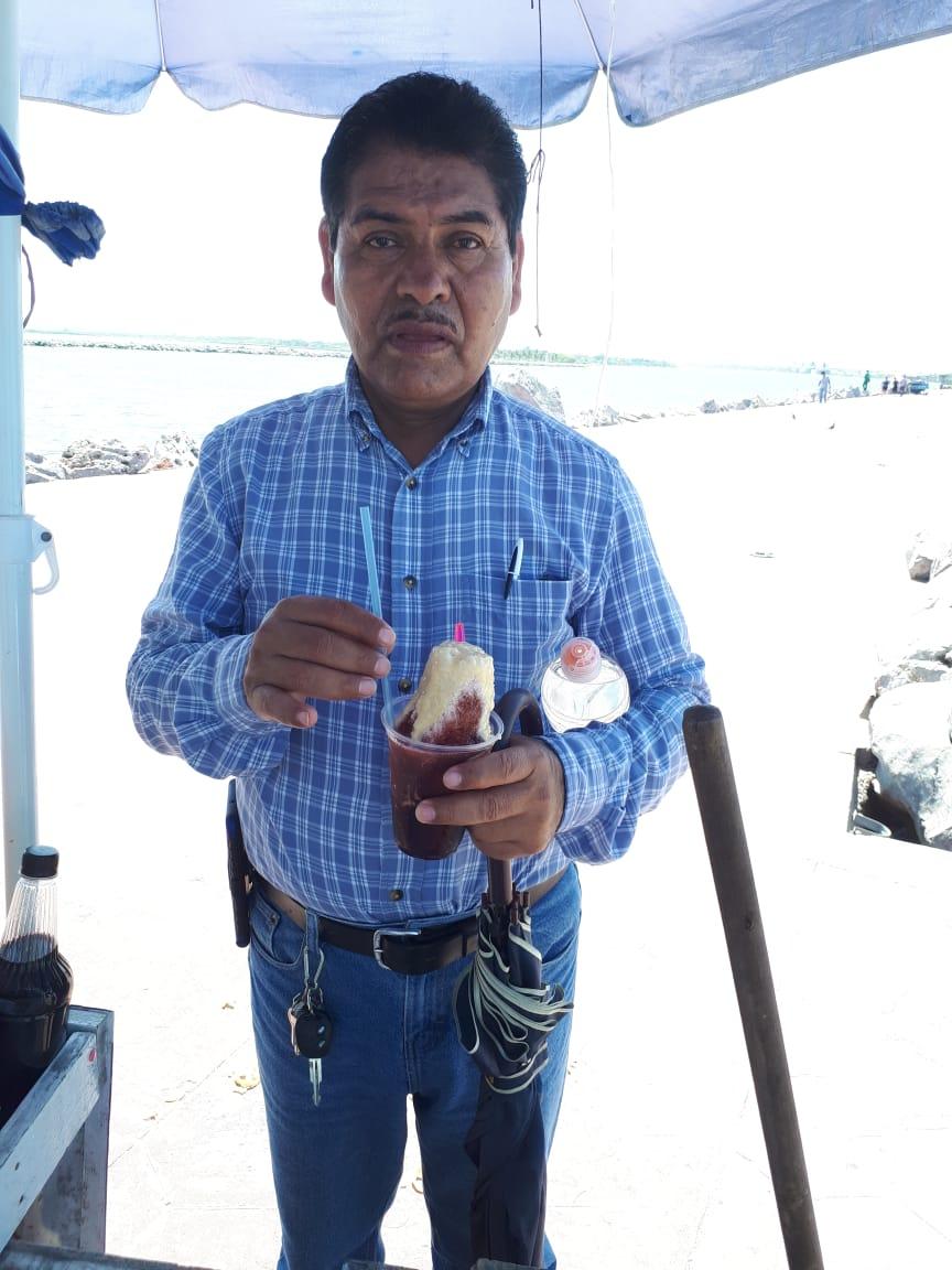 Pastor Bernardo enjoying his Respado (Ice Slushy)